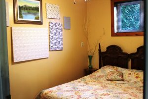 Our B & B accommodations include two rooms, one with a queen bed and one with two single beds.